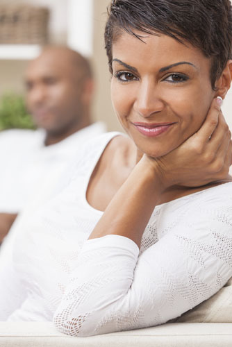 black-woman-with-short-hair-smiling-next-to-man-shutterstock-PF